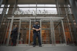 A police officer stands guard outside The New York Times building, Thursday, June 28, 2018, in New York. The New York Police Department has sent patrols to major news media organizations in response to a fatal shooting at a newspaper in Annapolis, Md. (AP Photo/Mary Altaffer)