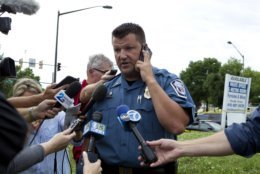 Maryland Police Lt. Ryan Frashure speaks to the media at the scene after multiple people were shot at a newspaper office building in Annapolis, Md., Thursday, June 28, 2018. (AP Photo/Jose Luis Magana)