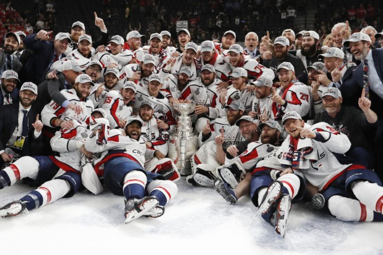 94a22847e Washington Capitals pose with the Stanley Cup after the Capitals defeated  the Golden Knights 4-3 in Game 5 of the NHL hockey Stanley Cup Finals.