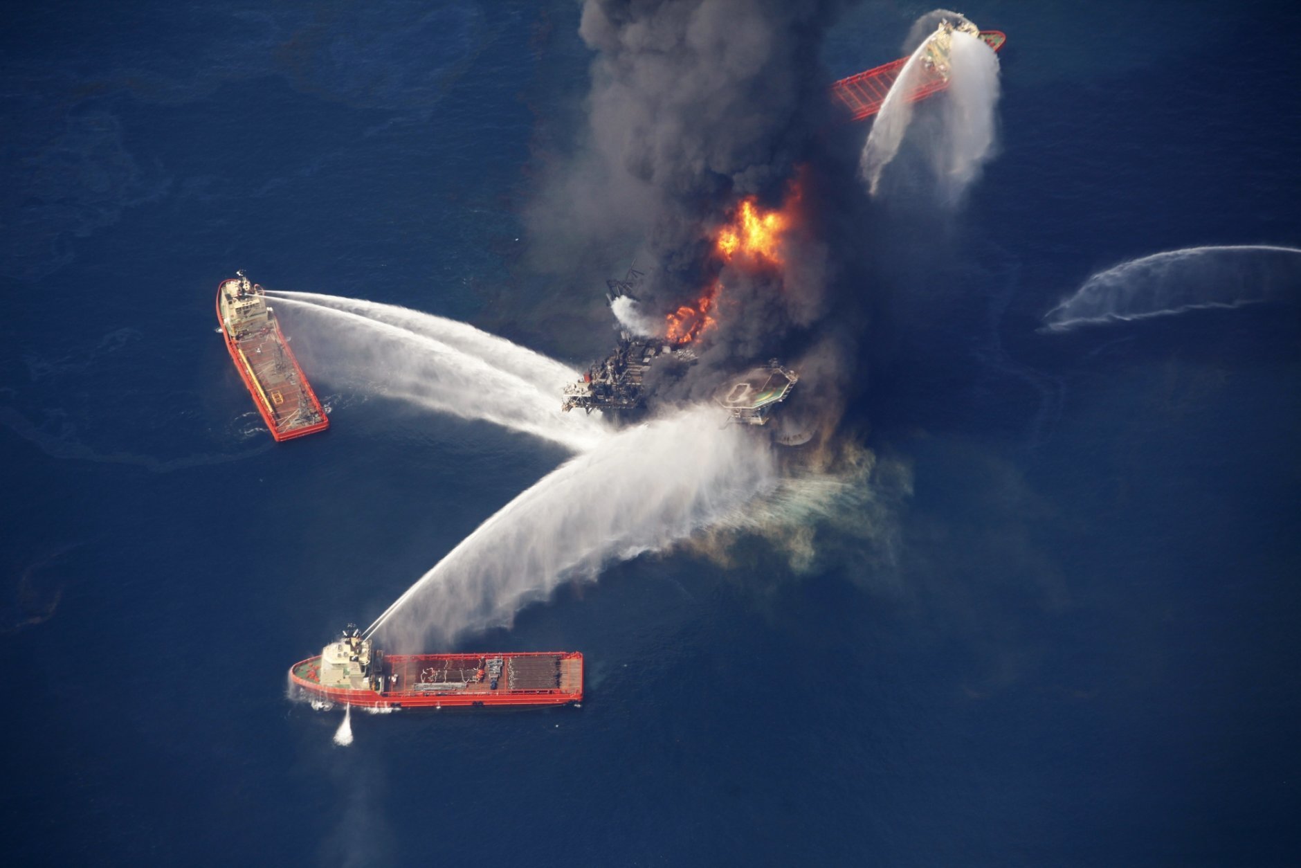 FILE - In this April 21, 2010, file photo, the Deepwater Horizon oil rig burns in the Gulf of Mexico following an explosion that killed 11 workers and caused the worst offshore oil spill in the nation's history. President Donald Trump is throwing out a policy devised by his predecessor for protecting U.S. oceans and the Great Lakes, replacing it with a new approach that emphasizes use of the waters to promote economic growth. President Barack Obama issued his policy in 2010 after the Deepwater Horizon oil spill in the Gulf of Mexico. Trump says it was too bureaucratic. (AP Photo/Gerald Herbert, File)