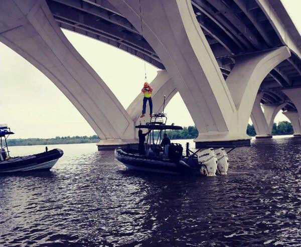 A construction worker is lowered onto a police boat that was patrolling the Potomac when its crew heard the boom and saw an explosion the Wilson Bridge. The officers rushed to help and positioned themselves to help rescue bridge workers who were lowered to safety. (Courtesy Prince George's County Police Department via Twitter)
