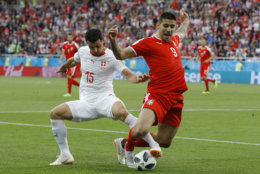 Switzerland's Blerim Dzemaili, left, and Serbia's Aleksandar Mitrovic battle for the ball during the group E match between Switzerland and Serbia at the 2018 soccer World Cup in the Kaliningrad Stadium in Kaliningrad, Russia, Friday, June 22, 2018. (AP Photo/Victor Caivano)