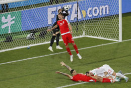 Switzerland goalkeeper Yann Sommer , top, and Serbia's Sergej Milinkovic-Savic battle for a high ball during the group E match between Switzerland and Serbia at the 2018 soccer World Cup in the Kaliningrad Stadium in Kaliningrad, Russia, Friday, June 22, 2018. Switzerland won 2-1. (AP Photo/Antonio Calanni)