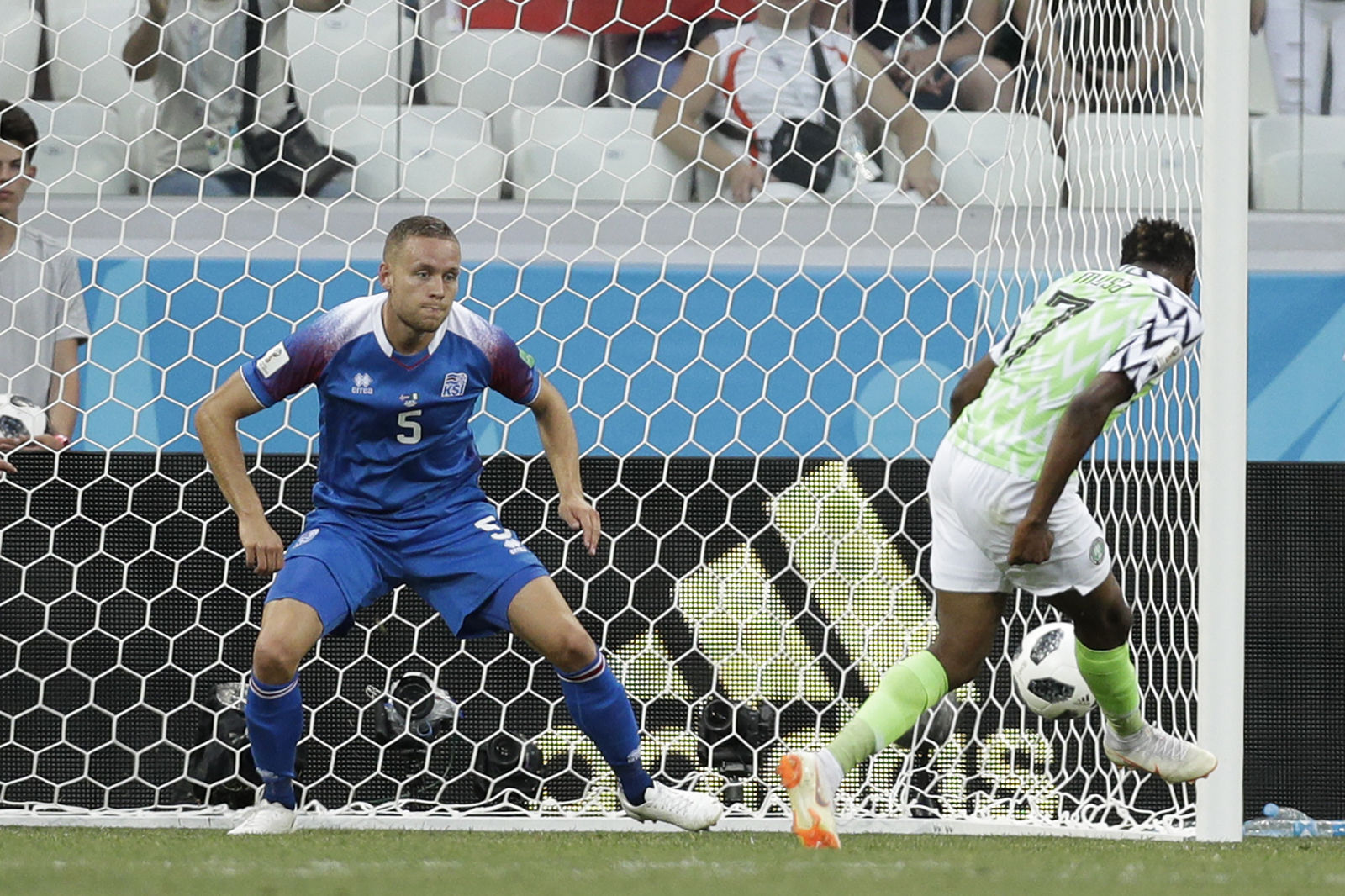 Nigeria's Ahmed Musa, right, kicks past Iceland's Sverrir Ingason to score his side's second goal during the group D match between Nigeria and Iceland at the 2018 soccer World Cup in the Volgograd Arena in Volgograd, Russia, Friday, June 22, 2018. (AP Photo/Andrew Medichini)
