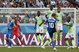 Iceland's Gylfi Sigurdsson takes a free kick during the group D match between Nigeria and Iceland at the 2018 soccer World Cup in the Volgograd Arena in Volgograd, Russia, Friday, June 22, 2018. (AP Photo/Darko Vojinovic)
