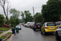 Traffic backs up on East Taylor Run Parkway on May 16, 2018. Drivers cutting through the street are known for blocking driveways, striking parked cars, cursing out residents and honking their horns in stopped traffic. Neighbors have been complaining to the Alexandria city officials for years, as well as to the police. (WTOP/Colleen Kelleher)
