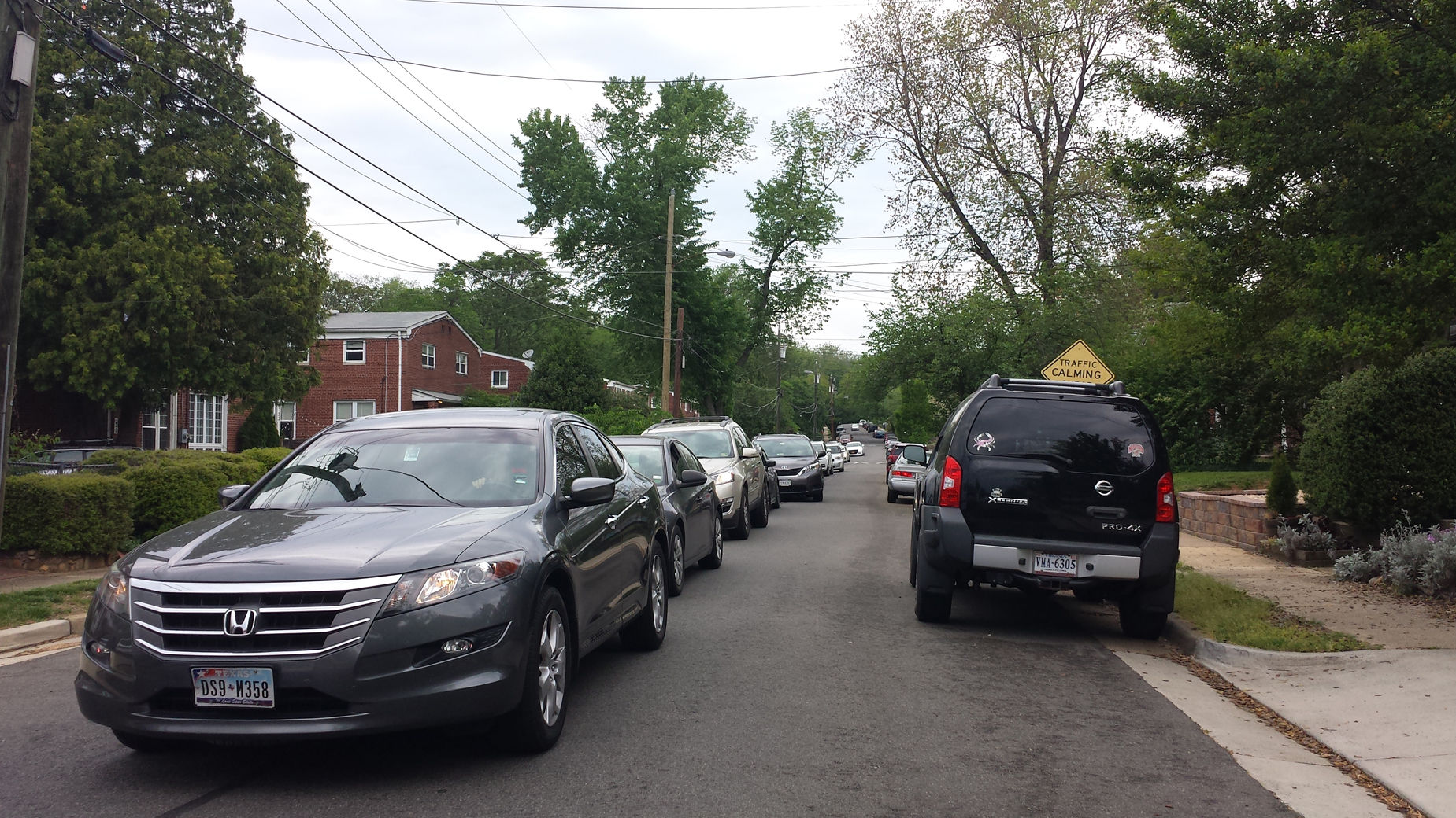 Drivers cutting through this Alexandria street with approximately 80 homes often wait long periods of time to turn onto a Duke Street service road. Apps direct them to the street, even though it is often faster to take a parallel street that has two traffic lights. (WTOP/Colleen Kelleher)