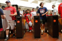 People use the turnstiles as they exit the National Archives Metro Subway station and head towards the Washington Capitals Stanley Cup victory parade on the National Mall in Washington, Tuesday, June 12, 2018. (AP Photo/Pablo Martinez Monsivais)