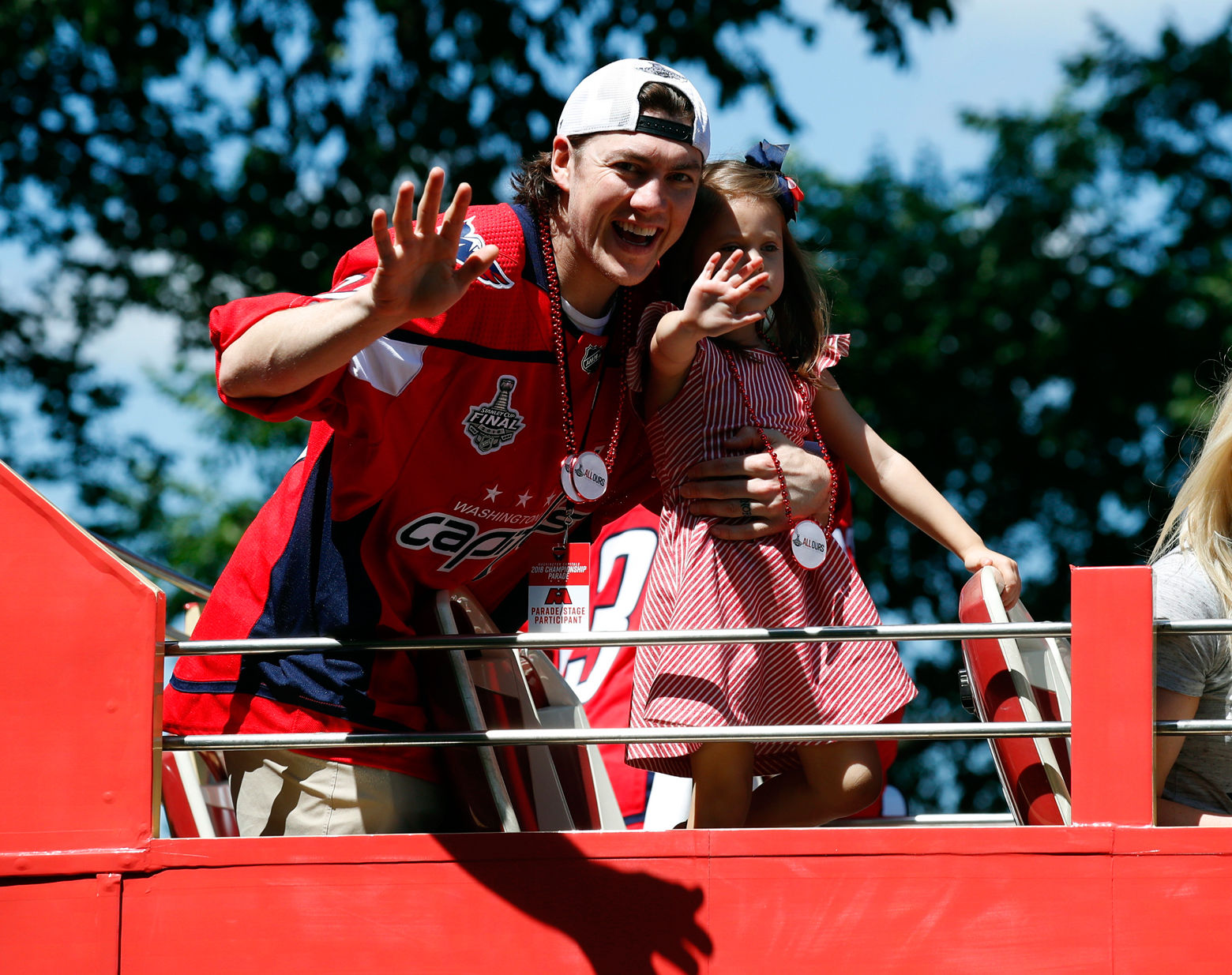 Washington Capitals right wing T.J. Oshie waves while holding his daughter Lyla Oshie during a Stanley Cup NHL hockey victory parade, Tuesday, June 12, 2018, in Washington. (AP Photo/Alex Brandon, Pool)
