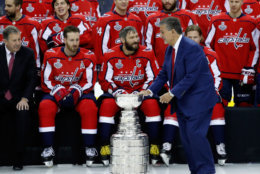 Ted Leonsis touches the Stanley Cup during the team picture with the Stanley Cup on the ice at Capital One Arena, Tuesday, June 12, 2018, in Washington. (AP Photo/Alex Brandon)