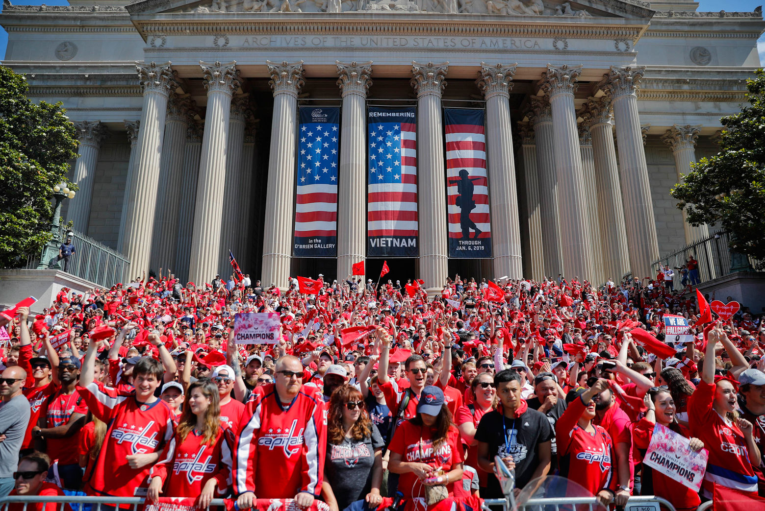 Fans gather on the steps of the National Archives Building as they wait to watch the Capitals parade along the National Mall. (AP Photo/Pablo Martinez Monsivais)