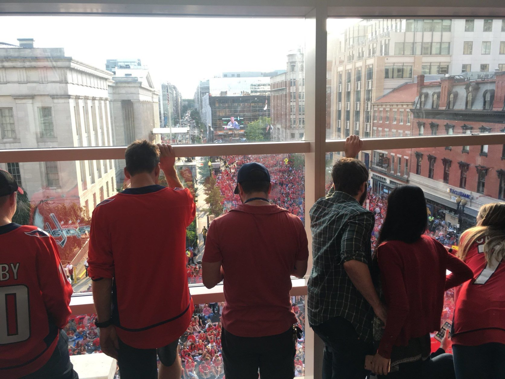 Inside Capital One Arena, looking out on the crowd-filled streets. (WTOP/Noah Frank)