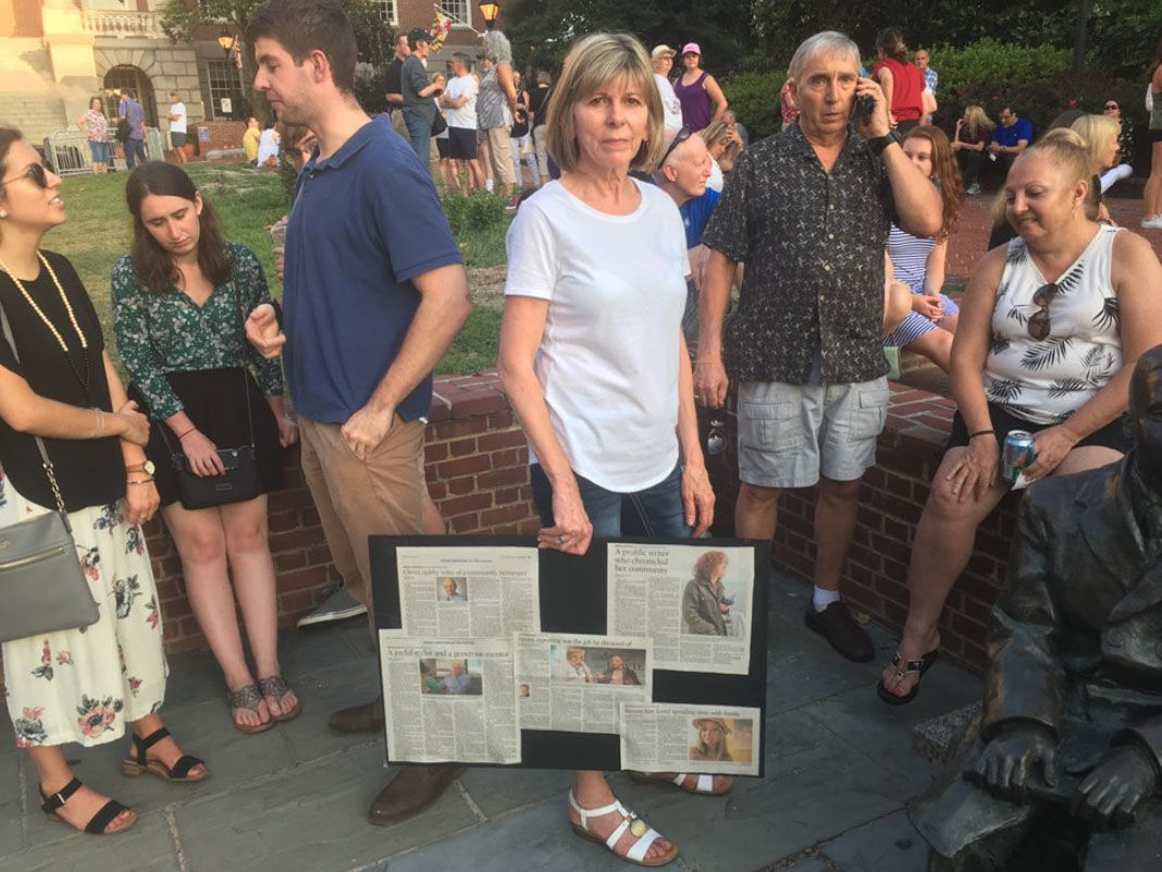 Kathy Korin, of Annapolis, joins the vigil on Friday, June 29, 2018, for the victims of the Capital Gazette shooting. (WTOP/Mike Murillo)