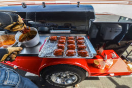 Tuffy stone prepares chicken during a barbecue competition. Judges must receive identical portions on deadline at this weekend's barbecue battle. (Courtesy Ken Goodman)