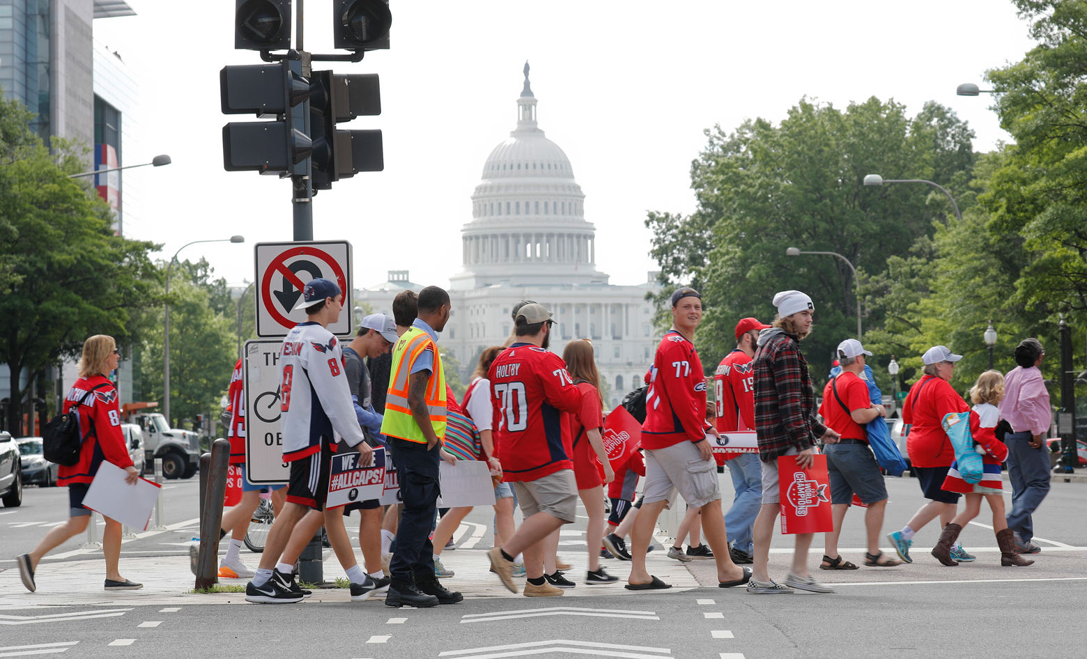 Fans cross Pennsylvania Ave., as they head towards the Washington Capitals Stanley Cup victory parade route on the National Mall in Washington, Tuesday, June 12, 2018. (AP Photo/Pablo Martinez Monsivais)