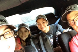 Anne Hoffman sent in this photo of her family decked out in Caps gear on the way into D.C. for the parade. (Courtesy Anne Hoffman)