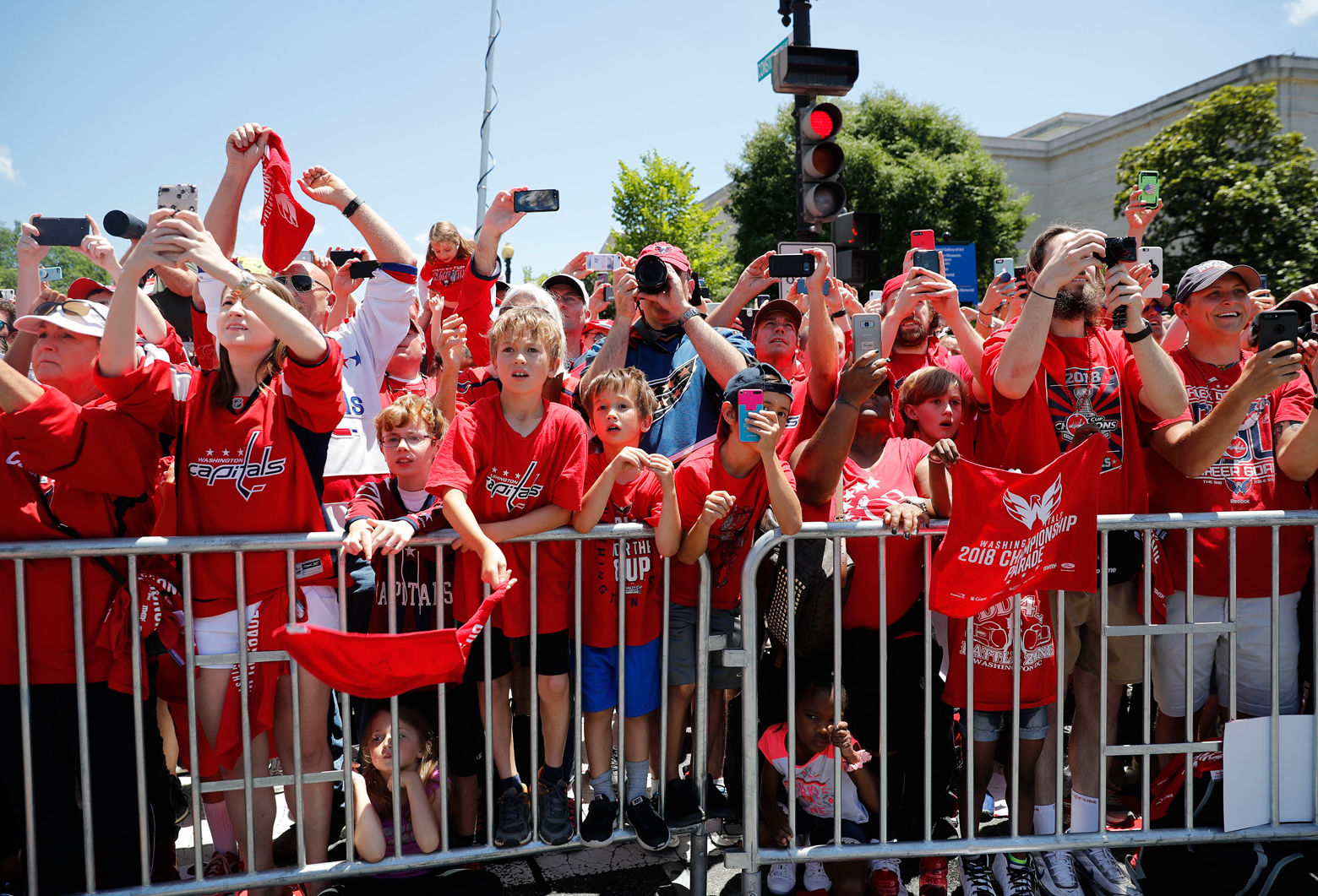 Fans react to the bus going past. (AP Photo/Pablo Martinez Monsivais)
