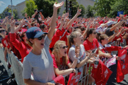 Fans wave as they watch the parade. (AP Photo/Pablo Martinez Monsivais)