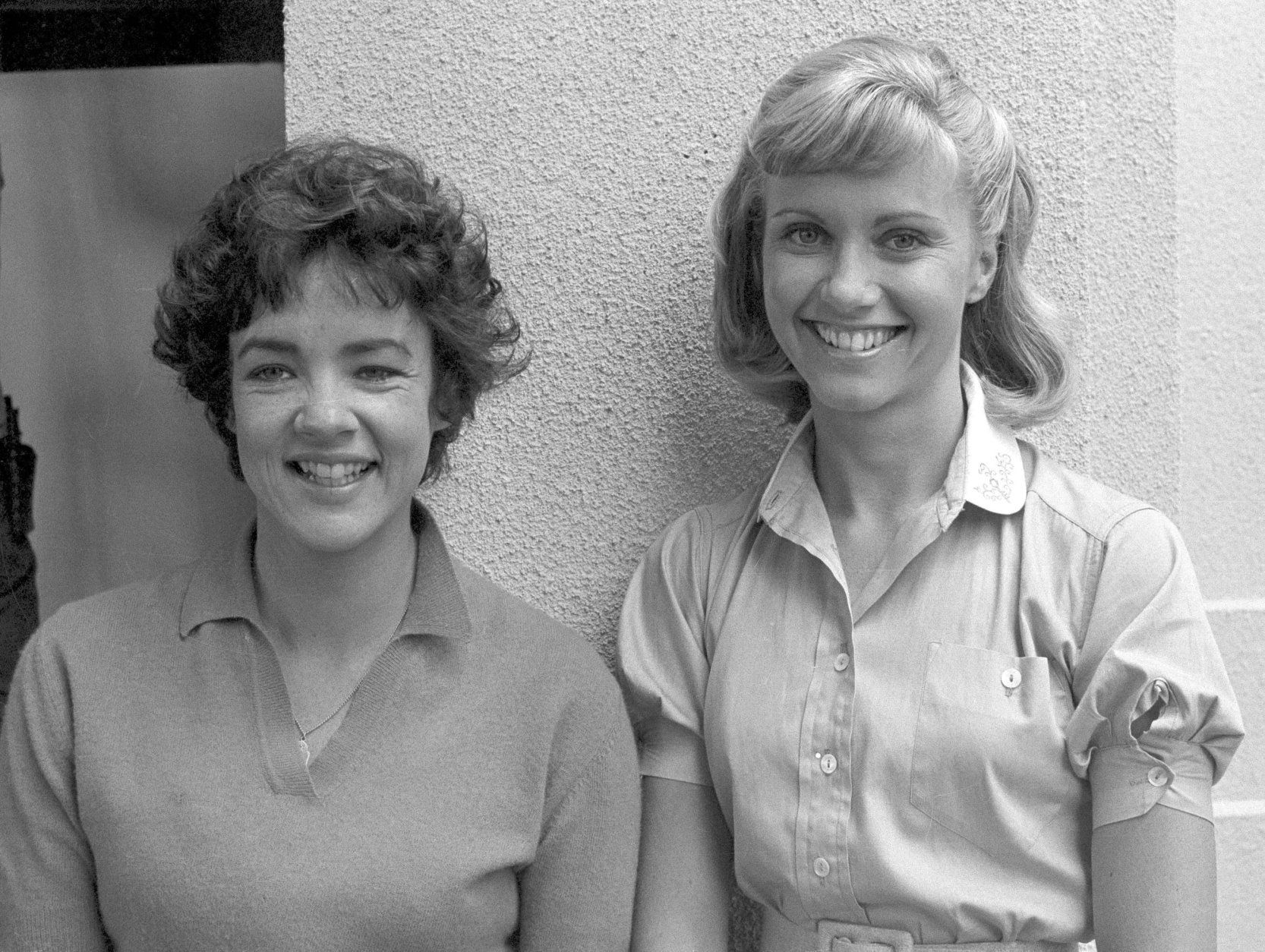 "Actresses and co-stars Stockard Channing, left, and Olivia Newton-John ready themselves for their roles in the movie version of ""Grease,"" in Los Angeles, Aug. 30, 1977.  Ms. Channing  and Ms. Newton-John star with John Travolta in the film.  (AP Photo/Nick Ut)"