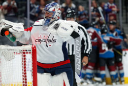 Washington Capitals goalie Philipp Grubauer, front, reacts after giving up a goal to Colorado Avalanche left wing Gabriel Landeskog, back, of Sweden, who celebrates with teammates in the first period of an NHL hockey game Thursday, Nov. 16, 2017, in Denver. (AP Photo/David Zalubowski)