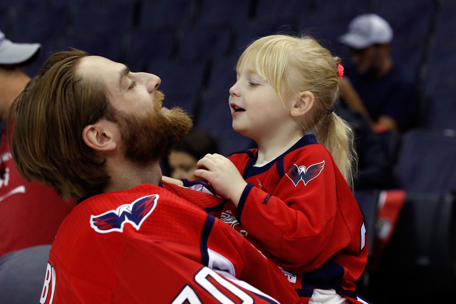 Washington Capitals goaltender Braden Holtby holds his daughter Belle Holtby on the ice after the Capitals NHL hockey team posed for a team picture with the Stanley Cup on the ice at Capital One Arena. (AP Photo/Alex Brandon)