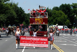 Ice girls lead the team bus during the parade. (AP Photo/Alex Brandon, Pool)
