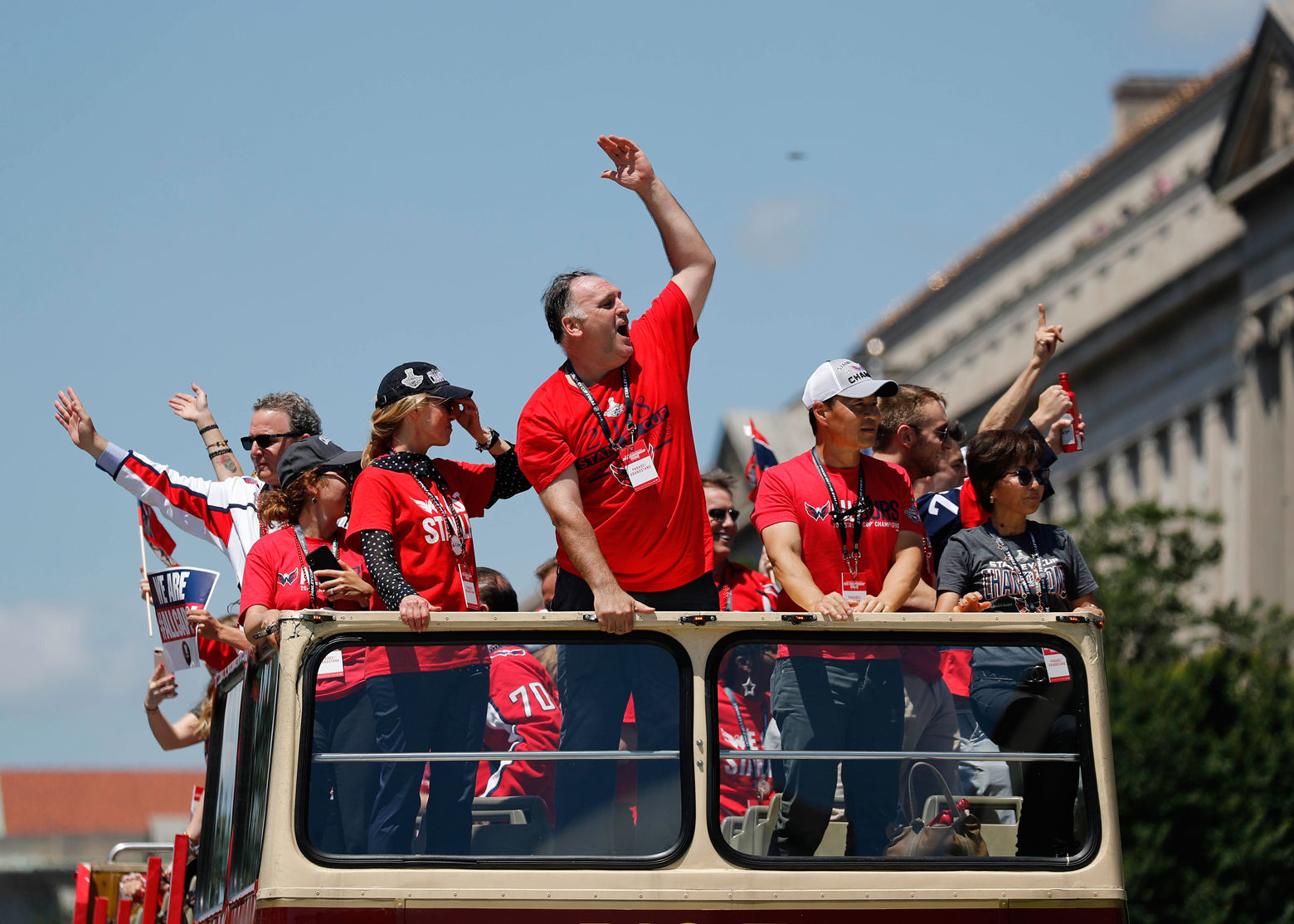 Chef Jose Andres, center, gestures while celebrating during the Washington Capitals NHL hockey Stanley Cup victory. (AP Photo/Pablo Martinez Monsivais)