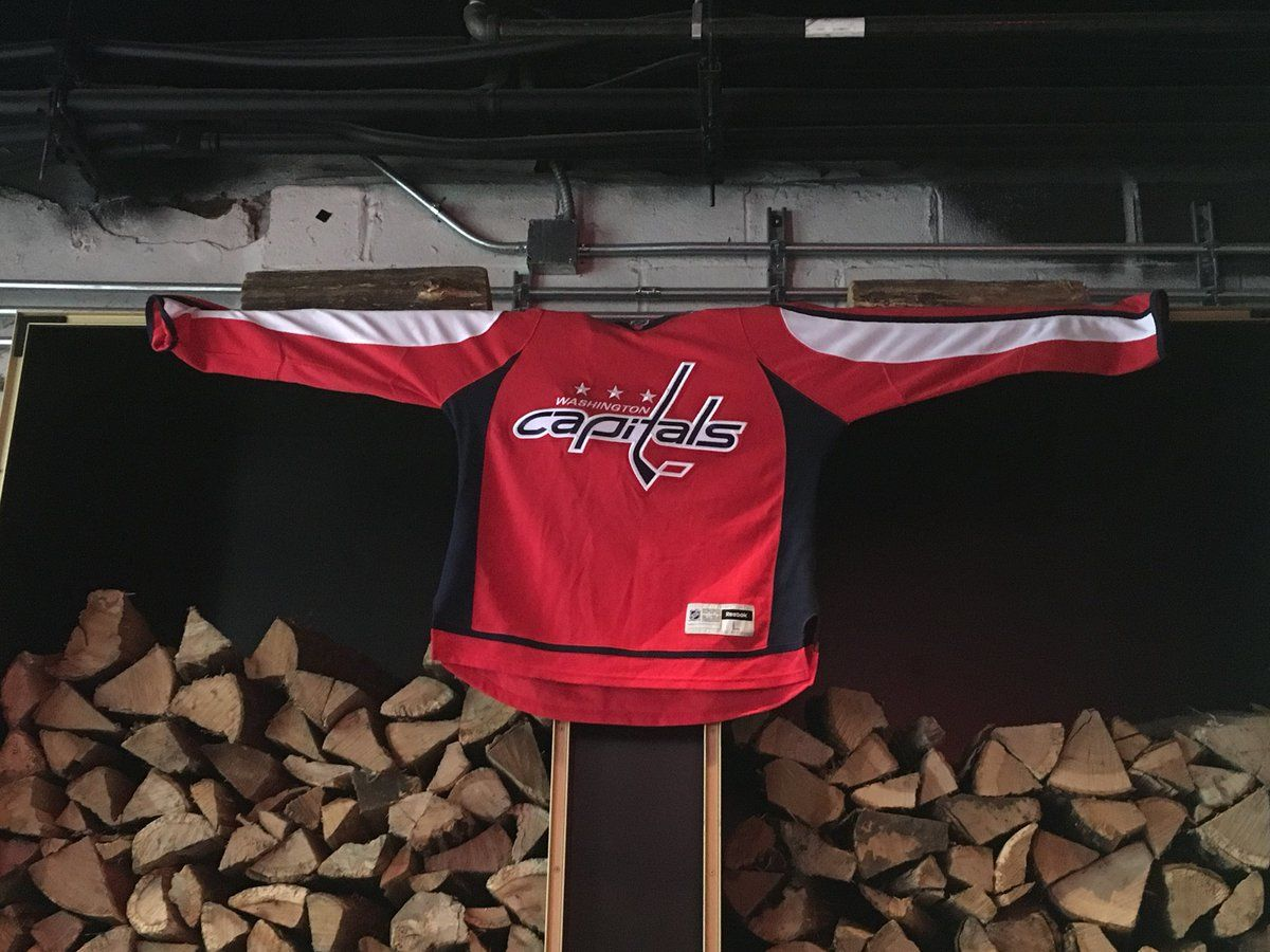 A Caps jersey greets fans with open arms at Bar Deco along 6th Street in Northwest D.C. (WTOP/Liz Anderson)