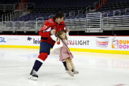Washington Capitals NHL hockey team right wing T.J. Oshie (77) skates with his daughter Lyla Oshie after the Capitals team picture on the ice at Capital One Arena, Tuesday, June 12. (AP Photo/Alex Brandon)