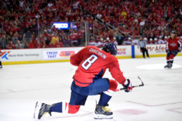 Washington Capitals left wing Alex Ovechkin (8), of Russia, celebrates his goal during the first period of a NHL hockey game against the Montreal Canadiens, Saturday, Oct. 7, 2017, in Washington. (AP Photo/Nick Wass)