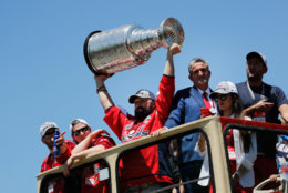 Ovechkin holds up the Stanley Cup during the parade along the National Mall in Washington, Tuesday, June 12, 2018. (AP Photo/Pablo Martinez Monsivais)