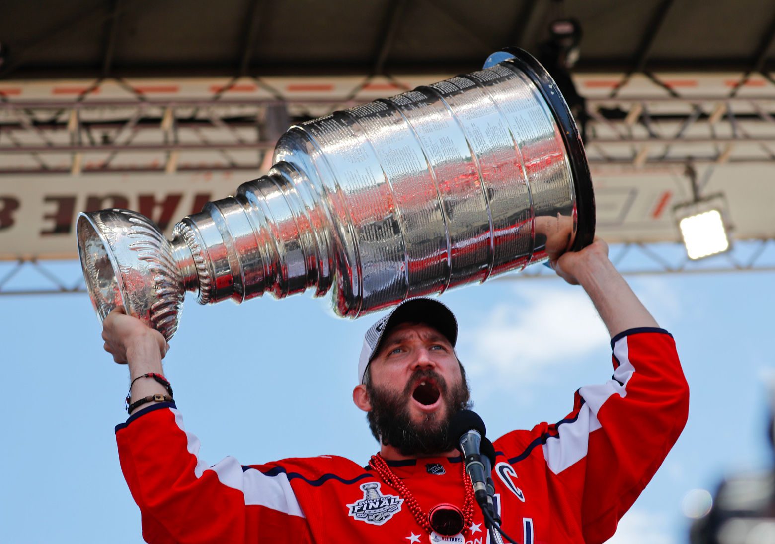 The moment everyone was waiting for: Alex Ovechkin raises the Stanley Cup on the rally stage in front of the U.S. Capitol Building on Tuesday. (AP Photo/Pablo Martinez Monsivais)