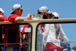 Alex Ovechkin kisses his wife Nastya Ovechkina, right, as they exit the bus during the Stanley Cup victory parade. (AP Photo/Pablo Martinez Monsivais)