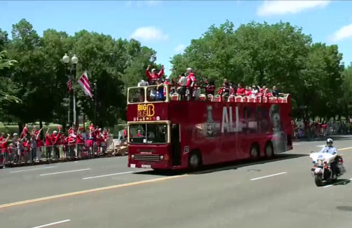 The Stanley Cup champs sat atop a bright red bus for the parade. (Screenshot of via NBC Washington livestream)