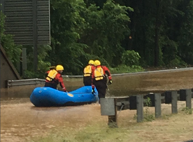 Members of the Prince George's County Swift Water Rescue team conduct a rescue on a trapped motorist on Sunday, June 3, 2018. (Courtesy Prince George's County Fire/EMS)