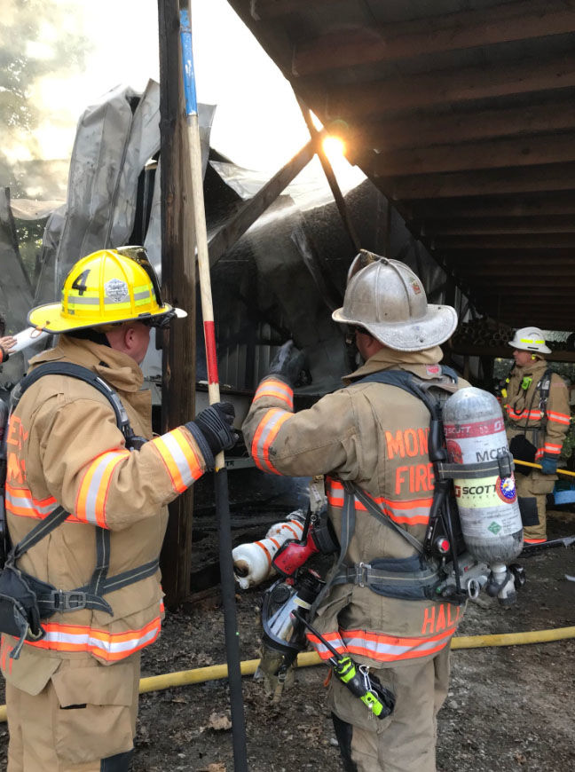 Firefighters inspect the damages after a fire broke out in a shed in Seneca Creek State Park (Courtesy Montgomery County Fire and EMS)