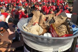 At least one trash can near Capital One Arena was at capacity hours before game time. (WTOP/Kristi King)