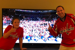 From the comfort of their home, two WTOP listeners join in on the Caps' team photo. (Courtesy WTOP Listeners)