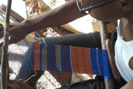 Ghanaian weaver Kofi Asare, son of Kwasi Asare, weaves Kente cloth on a loom. (Kwasi Asare)
