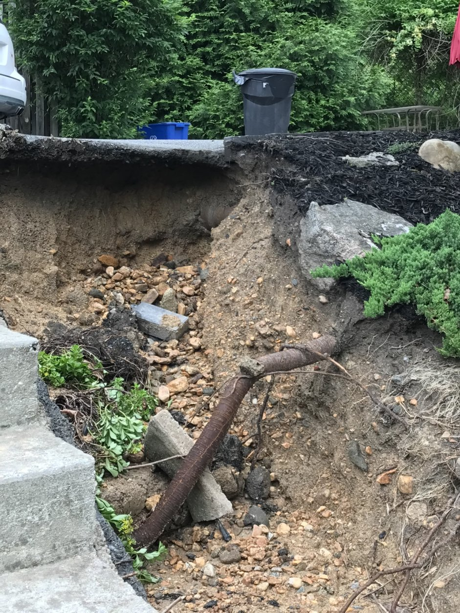 Torrential flash floods turned a creek beside Hollis Karr's home into a raging river, tearing away the front yards of several homes on Westchester Ave. in Ellicott City. (Courtesy Hollis Karr)