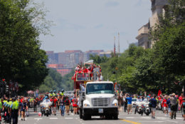 Alex Ovechkin holds up the Stanley Cup during the victory parade route on Constitution Avenue.(AP Photo/Pablo Martinez Monsivais)