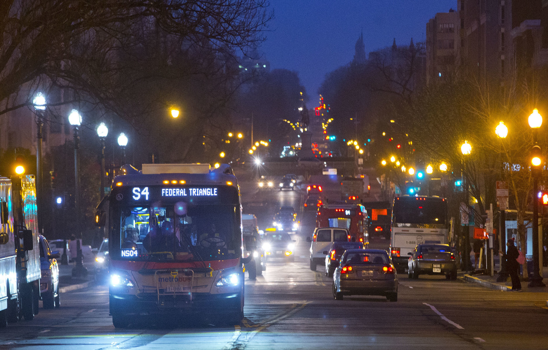 A Metrobus makes its way down 16th Street in downtown D.C., Wednesday, March 16, 2016. (AP Photo/Pablo Martinez Monsivais)