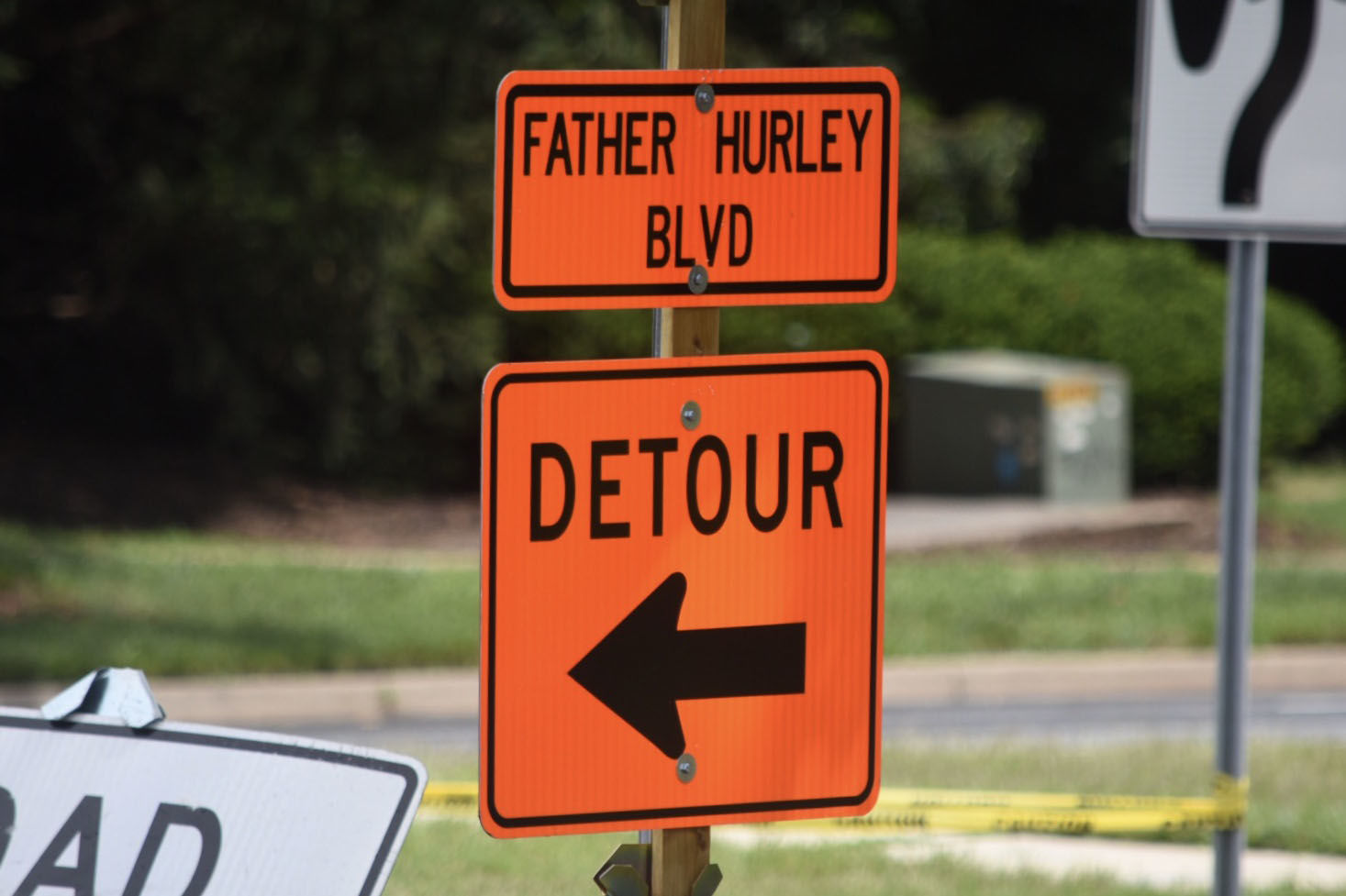 The work to fix the flood-damaged section of Father Hurley Boulevard between Crystal Rock Drive and Middlebrook Road near Waters Landing Drive continued July 24. (WTOP/Dave Dildine)