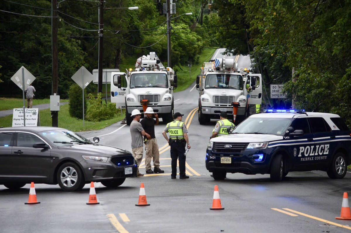 In Great Falls, Georgetown Pike is blocked east of Walker Rd. after a truck snagged wires. With the ground saturated, other parts of the byway have been blocked in the past few days as trees topple over. (WTOP/Dave Dildine)