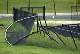 A warped fence is seen near Thomas Jefferson High School July 25, 2018. An EF-0 tornado briefly touched down early in the morning July 24, damaging several trees and two sheds. (WTOP/Dave Dildine)