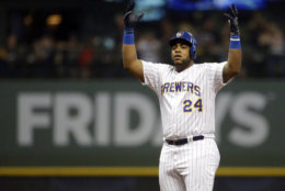 Milwaukee Brewers' Jesus Aguilar reacts after hitting a double during the fifth inning of a baseball game against the Atlanta Braves, Friday, July 6, 2018, in Milwaukee. (AP Photo/Aaron Gash)