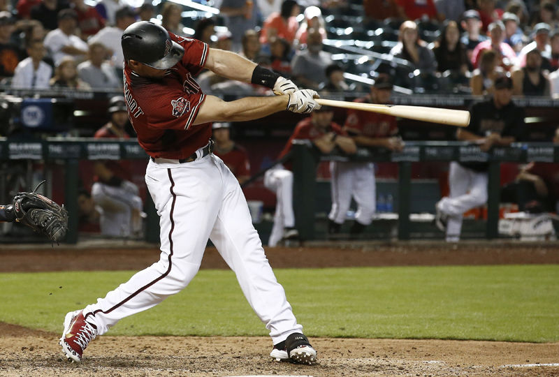 Arizona Diamondbacks' Paul Goldschmidt connects for a two-run home run against the San Francisco Giants during the seventh inning of a baseball game Sunday, July 1, 2018, in Phoenix. (AP Photo/Ross D. Franklin)