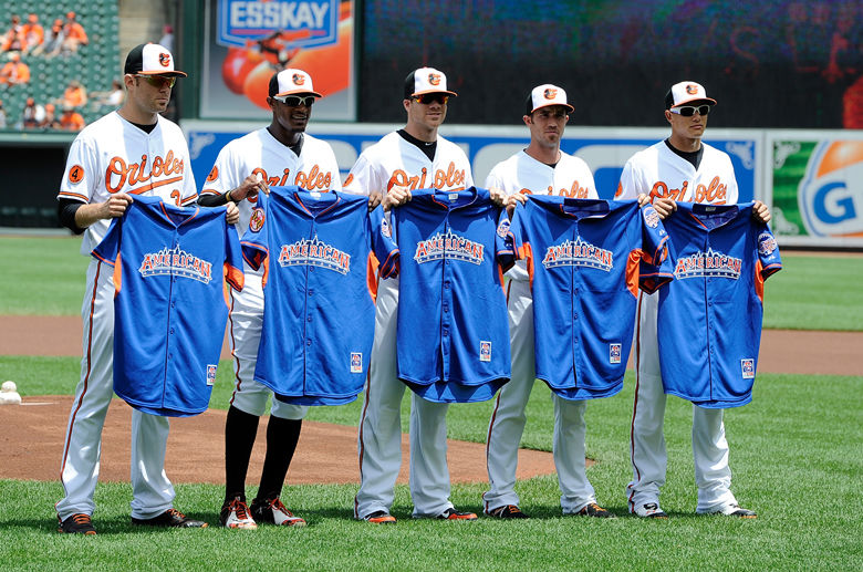 BALTIMORE, MD - JULY 14: Chris Tillman #30, Adam Jones #10, Chris Davis #19, J.J. Hardy #2 and Manny Machado #13 of the Baltimore Orioles pose for a photo with their All Star jersey before the game against the Toronto Blue Jays at Oriole Park at Camden Yards on July 14, 2013 in Baltimore, Maryland. (Photo by Greg Fiume/Getty Images)