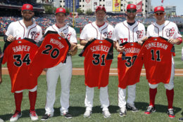 Washington Nationals right fielder Bryce Harper, left, second baseman Daniel Murphy, starting pitcher Max Scherzer, starting pitcher Stephen Strasburg and first baseman Ryan Zimmerman hold their National League All-Star jerseys before a baseball game against the Atlanta Braves at Nationals Park, Sunday, July 9, 2017, in Washington. (AP Photo/Alex Brandon)