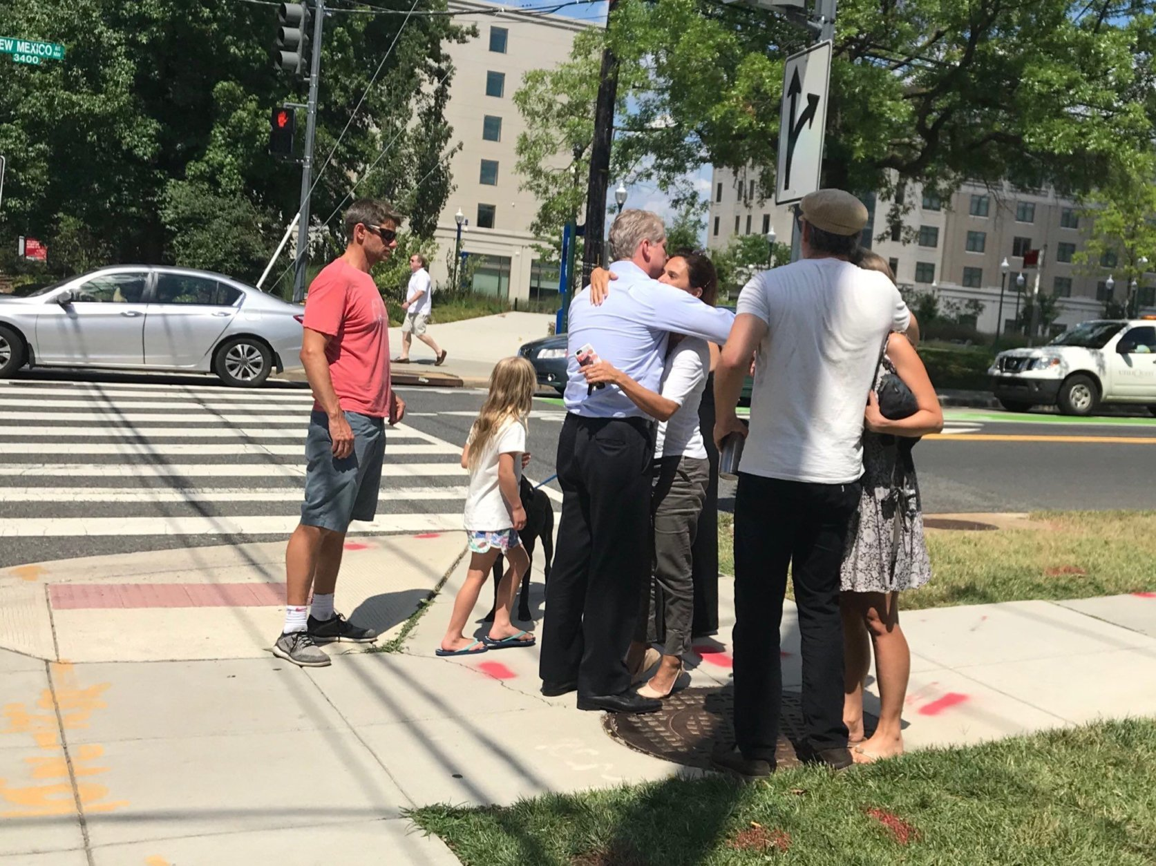 Concerned parents of children attending a basketball camp at Bender Arena gather near AU's main campus. (WTOP/Dick Uliano)